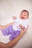 Newborn awakes. Photo of newborn baby in mother's arms Stock Photos