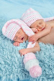 Newborn babies with pink hats Royalty Free Stock Images