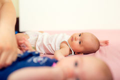 Newborn babies - twin sisters together with their mother. Royalty Free Stock Images