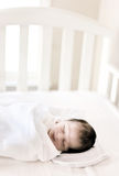 Newborn baby. Sleeping on his crib Stock Photography