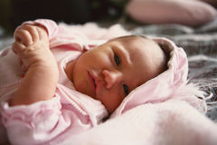 Newborn baby. Girl awake and looking into camera Stock Image