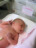 Newborn Baby. Lying on blanket in hospital Royalty Free Stock Photos