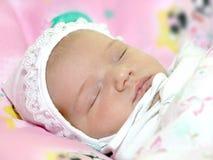 Newborn baby. Close-up face of one week aged newborn baby Stock Photos