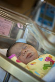 Newborn Baby. A newborn baby is sleeping in the hospital stock image