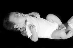 Newborn Baby. Sleeping in his Father's Arm stock photography