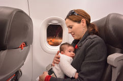 Newborn Baby air travel. Mother carry her newborn baby during flight.Concept photo of air travel with baby Royalty Free Stock Photo