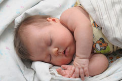 Newborn baby with allergic sleeps Royalty Free Stock Image