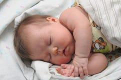 Newborn baby with allergic sleeps Royalty Free Stock Image