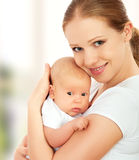 Newborn baby in the arms of mother Stock Images