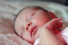 Newborn baby asleep. Newborn baby peacefully asleep on bed Royalty Free Stock Photo