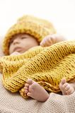 Newborn baby with bare feet Stock Photo