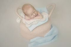 Newborn baby in basket stock photo