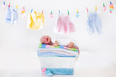 Newborn baby in a basket with towels Royalty Free Stock Photos
