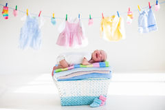 Newborn baby in a basket with towels royalty free stock photo