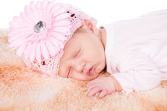 Newborn baby. Beautiful female newborn baby with pink flowersleeping Royalty Free Stock Photos