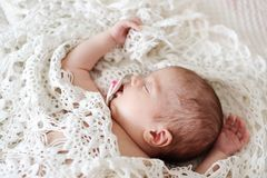 Newborn baby on the bed stock photography