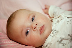 Newborn baby at the bed Royalty Free Stock Photos