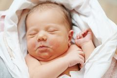 Newborn baby in bedsheet Royalty Free Stock Photography