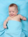 Newborn baby on blue stock photography