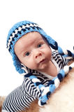 Newborn baby in blue hat Stock Photo