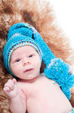 Newborn baby on blue knitted cap Royalty Free Stock Photo