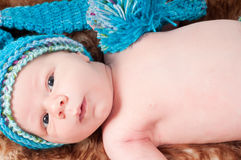 Newborn baby in blue knitted hat Stock Images