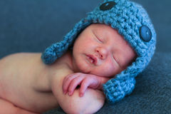 Newborn baby with bomber hat royalty free stock image