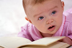 Newborn baby with a book Royalty Free Stock Images