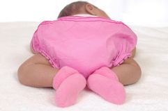 Newborn baby bottom in pink Stock Photos