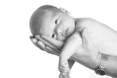 Newborn Baby boy. Beautiful newborn baby boy being held by his father Stock Photos