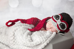 Newborn baby boy with airplane outfit Stock Image