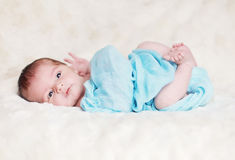 Newborn baby boy. An awake and active newborn baby swaddled in a blanket Royalty Free Stock Photos