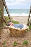 Newborn Baby Boy in Basket at Beach Stock Photos