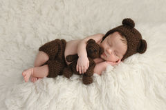 Newborn Baby Boy with Bear Hat and Toy Stock Photos