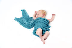 Newborn baby boy with blue wrap Royalty Free Stock Photos