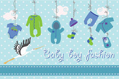 Newborn baby-boy clothes hanging on the rope.Baby fashion. Colorful clothes for newborn babyboy hanging on the rope on polka dot background. Design template Royalty Free Stock Image