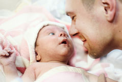 Newborn baby boy and dad stock photos