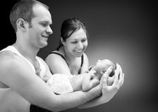Newborn baby boy on the father's and mother's hand Royalty Free Stock Images