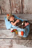 Newborn Baby Boy in Fisherman Outfit Stock Photography