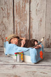 Newborn Baby Boy in Fisherman Outfit Stock Photos