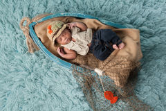 Newborn Baby Boy in Fisherman Outfit Royalty Free Stock Images