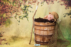 Newborn Baby Boy with Fishing Hat and Pole Royalty Free Stock Photography