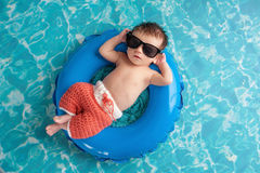 Newborn Baby Boy Floating on an Inner Tube Stock Photography