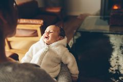 Mother sitting on sofa with her baby boy Royalty Free Stock Photography