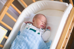 Newborn baby boy in hosptal cot royalty free stock photos