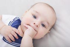 Newborn Baby Boy Laying Down Sucking His Fingers Stock Photo