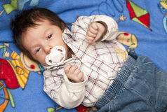Newborn baby boy with pacifier. Portrait of cute newborn baby boy with pacifier or dummy stock photos