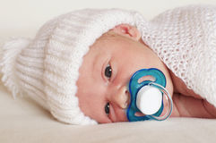 Newborn baby boy with pacifier Stock Photos