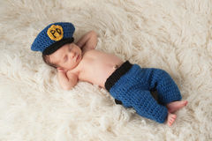 Newborn Baby Boy in Policeman's Uniform Royalty Free Stock Photo