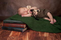 Newborn Baby Boy with Reading Glasses Stock Photo